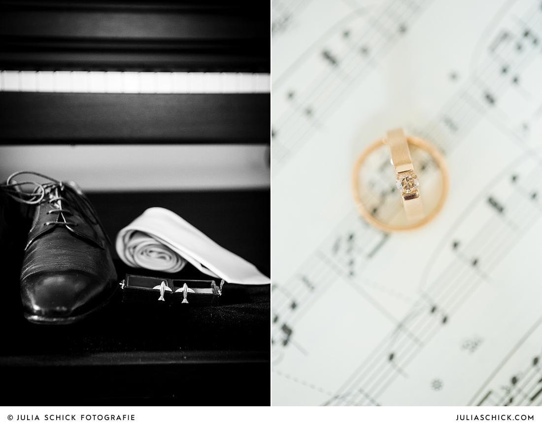 Manschettenknöpfe und Eheringe fotogtafiert von Hochzeitsfotografin Julia Schick