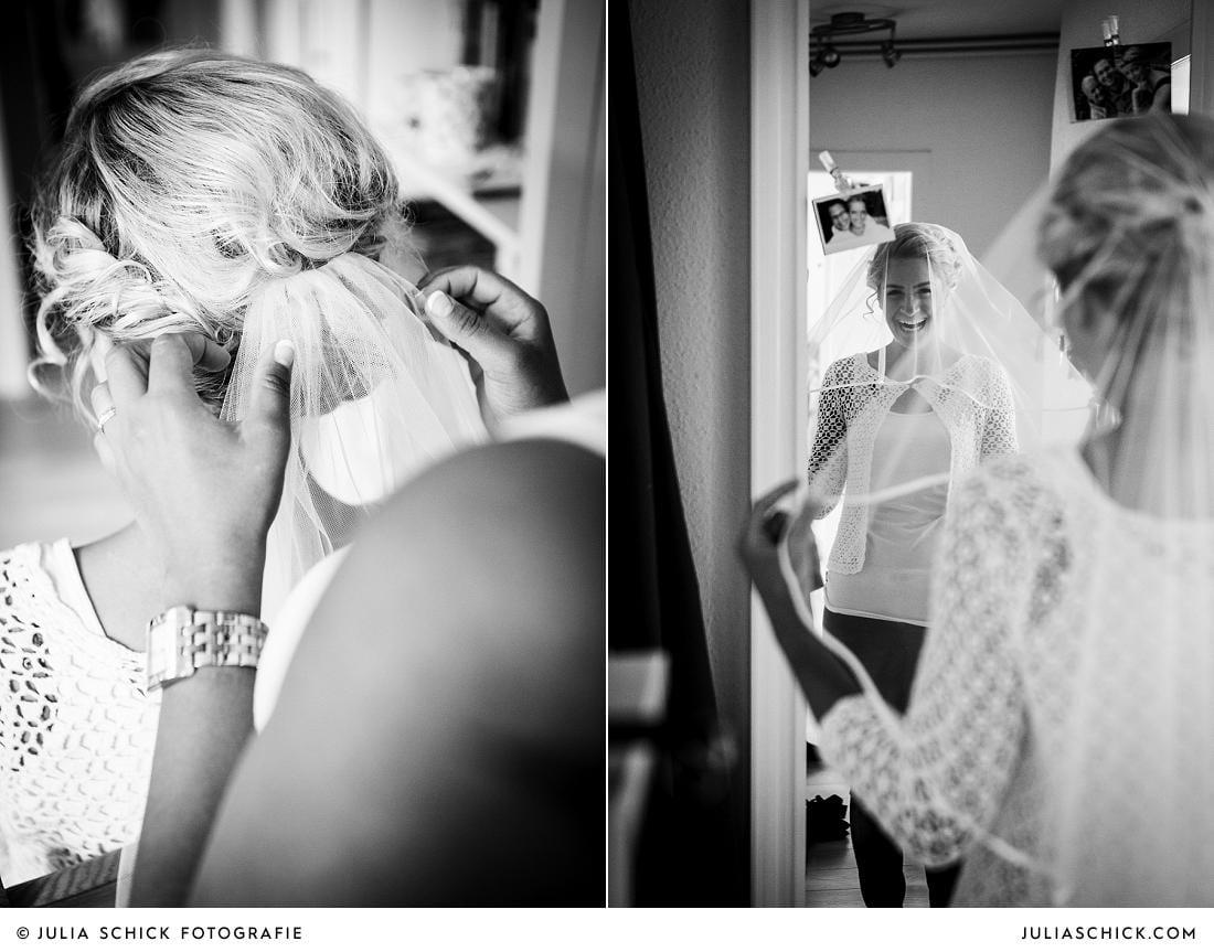 Visagistin Nasila di Piazza steckt Braut Schleier ins Haar