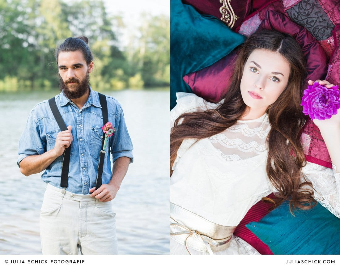 Bärtiger Bräutigam in Jeanshemd und Hosenträgern mit Anstecker, Braut liegend auf magenta und blauen Kissen mit lila Dahlie