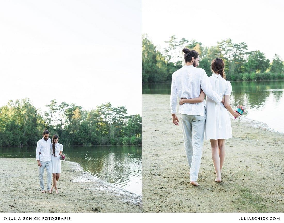 Hochzeitsfoto von Brautpaar an Seeufer