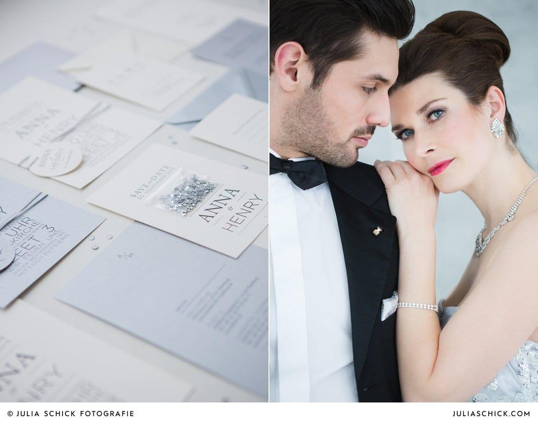 Hochzeitspapeterie in Silber, elegantes Brautpaar vor Sichtbetonwand mit Bräutigam im Smoking bei einem Hochzeits- Style- Shoot im Fleet 3 in Hamburg
