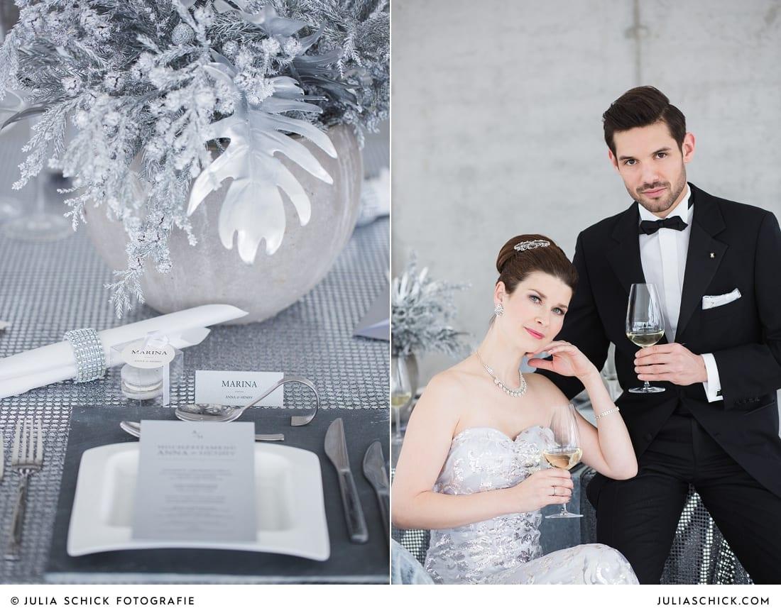 Brautpaar in Hochzeitsoutfits von MM Couture und Tischdekoration mit Menükarte passend zum Hochzeitskonzept zum Thema Beton meets Glamour im Fleet 3 in Hamburg Finkenwerder