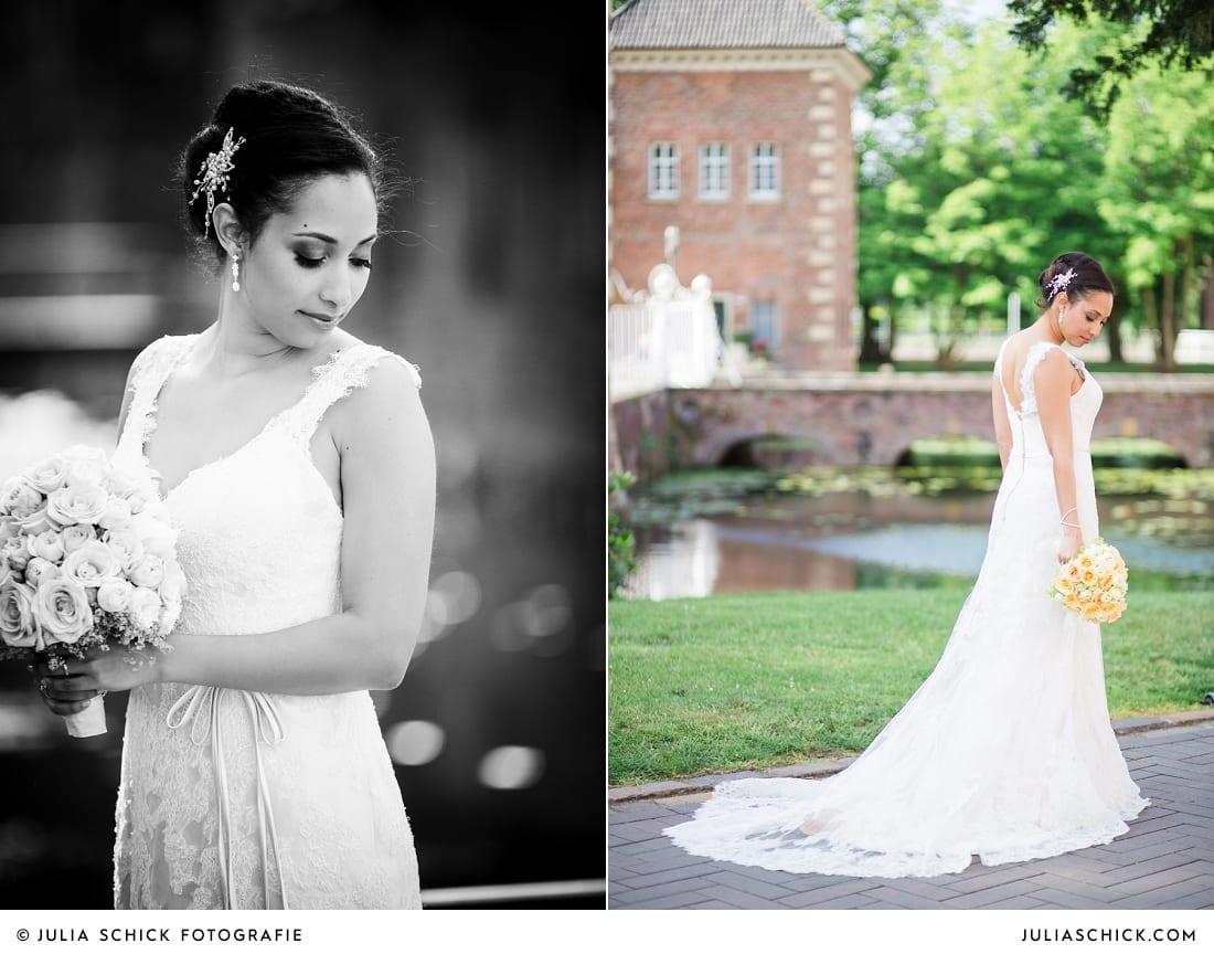 Braut vor dem Sportschloss Velen in Spitzenbrautkleid mit Schleppe