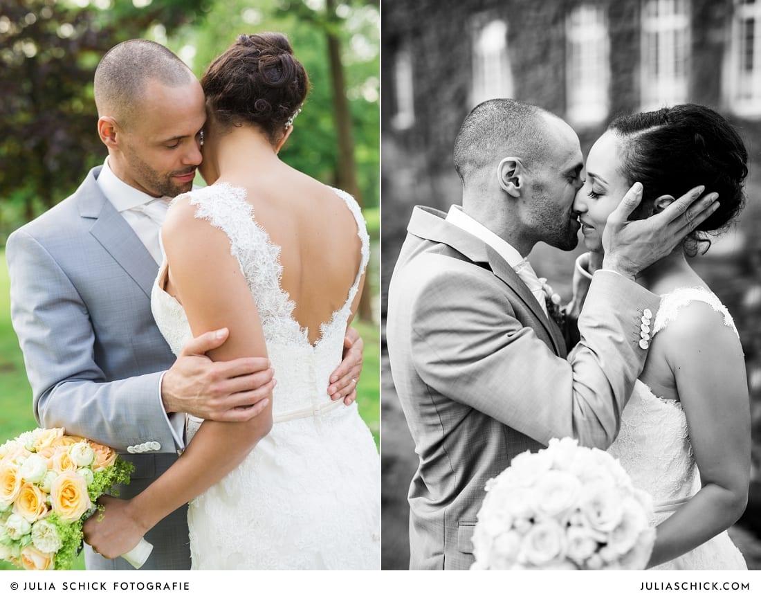 Küssendes Brautpaar vor Sportschloss Velen