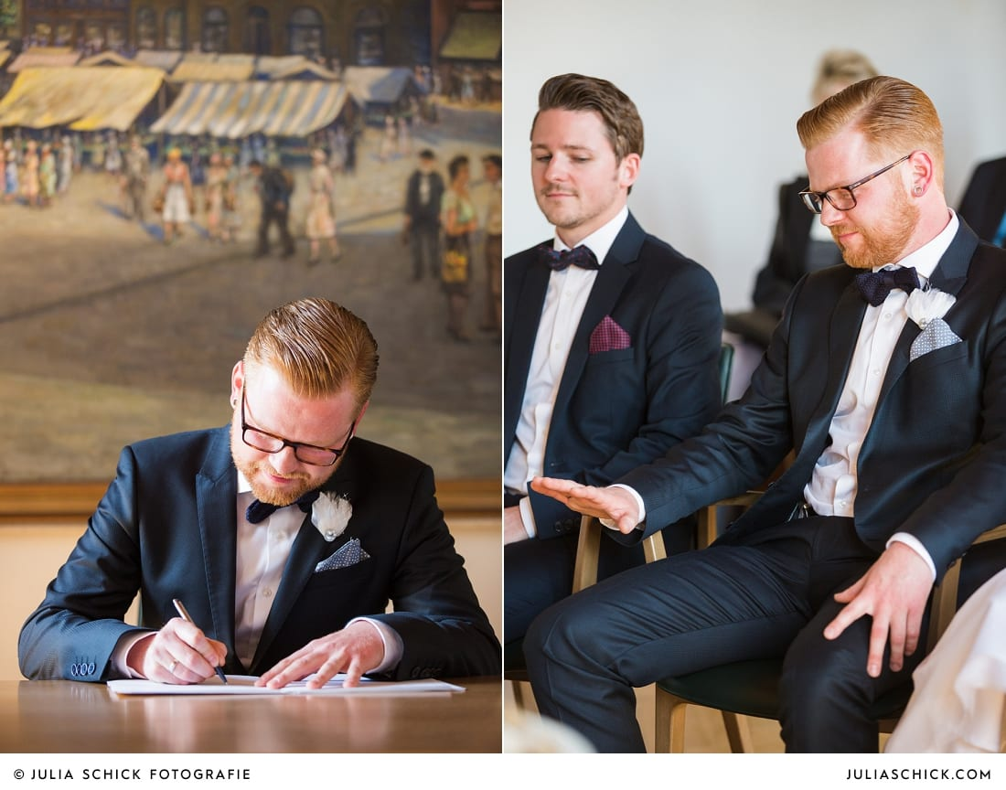 Bräutigam unterschreibt Eheurkunde nach standesamtlicher Trauung im alten Rathaus in Dortmund