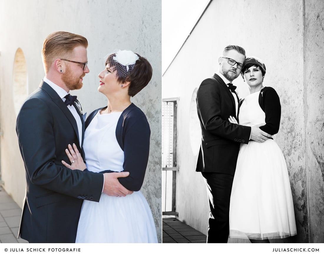 Brautpaar vor Betonwand
