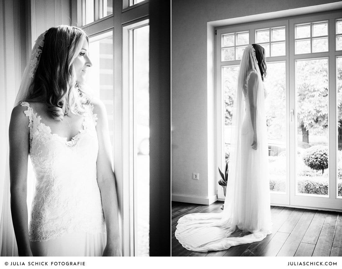 Foto von Braut am Fenster bei regnerischer Hochzeit