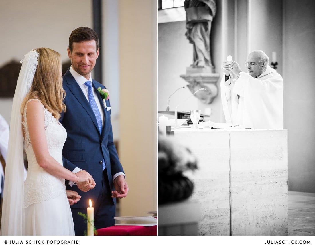 Brautpaar und Pfarrer während der Kommunion bei kirchlicher Hochzeit in der Kirche St. Mariä Himmelfahrt in Ahaus Alstätte