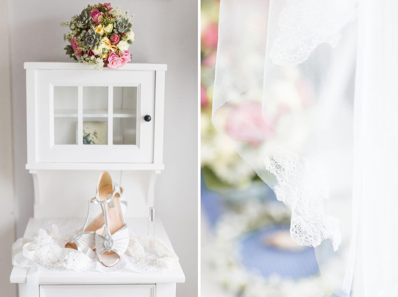 Brautschuhe und Schleier-Detail bei Hochzeitsfeier in Glücksburg