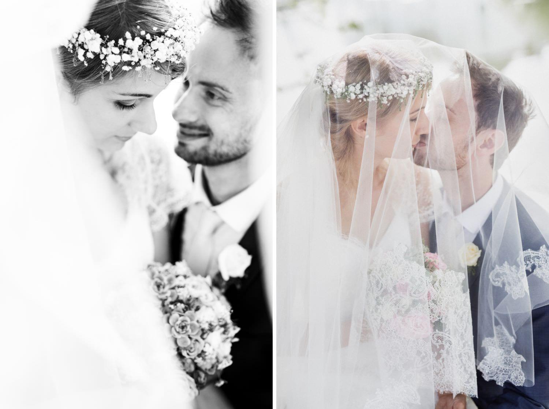 Braut und Bräutigam unter Schleier bei Boho-Hochzeit auf Schloss Glücksburg