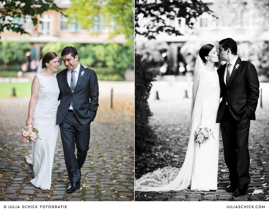 Braut in Brautkleid von Barbara Schwarzer und Bräutigam bei Hochzeitsfotoshooting auf Schloss Eicherhof in Leichlingen