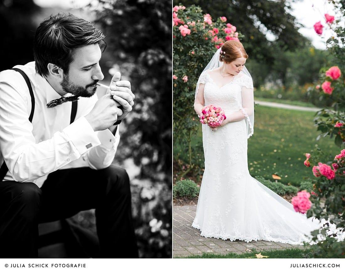 Rauchender Bräutigam und Braut umgeben von Rosen bei Hochzeitsfotoshooting im Rosengarten Seppenrade